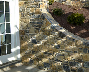Combine Beauty and Utility with a stone retaining wall by Pyle Bros Building Stone Contractors